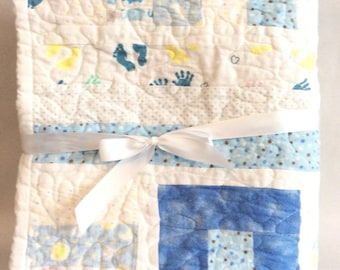 Warm and cozy handmade baby quilt, blue and white flannel
