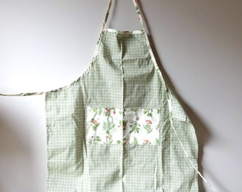Apron.  Green plaid apron with pockets.