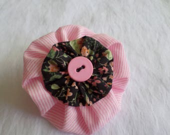 made with two yoyo flowers and a button pin pink
