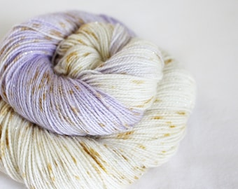 Navi - Magpie -  75/20/5 superwash merino/ nylon/ gold stellina sock yarn