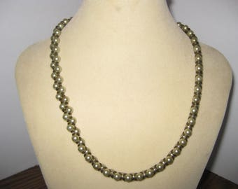 Glass bead necklace with brass 18 inches in length