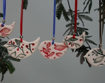 Porcelian Bird Ornament Decoration. These birds are embossed with the Tassie Berry on the front and leafy vine on the back.