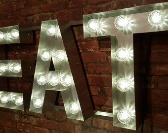 Marquee light up sign 'EAT'