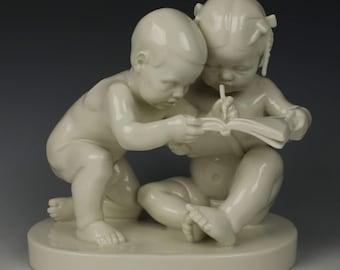 "Schwarzburger Figurine ""Boy and Girl Reading"""
