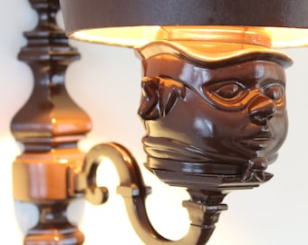wall lamp with masked head