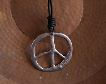 Aluminium  large Peace symbol medallion on heavy leather strap
