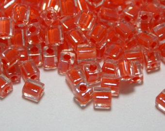 Miyuki Glass Seed Beads - Clear Square Beads with an Orange Center - 3.5 mm - 20 Grams About 225 Beads