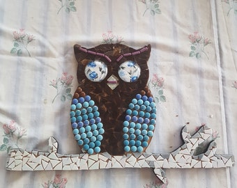 Mosaic Owl on a branch