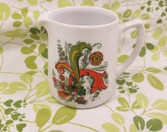 Vintage retro Creamer boho chic avocado green red burnt orange botanical design against white ceramic 1960s