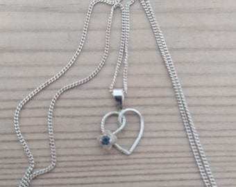 Vintage sterling silver heart shaped pendant with a sapphire and chain