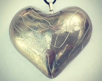 Large silver heart pendant.