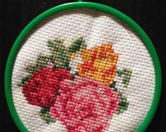 Red, Pink, and Yellow-Orange Roses with green frame & hanger (Cross Stitch)