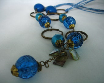Long blue geometric necklace - Acrylic, Metal, Mother of Pearl, Chain - Wax Cord