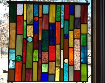 Stained glass panel, 11x11 inches, with copper frame
