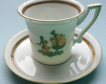 Vintage demitasse cup and saucer with romantic scene, marriage proposal