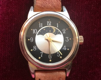 Womens Watch, Gold Bezel, Silver and Black Dial, Gold Hands, Moon Phase between 10 & 2, Date Window at 6, Tan Leather Band, Working Great