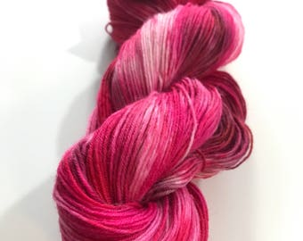 Hand dyed Merino and silk sock yarn in 50 shades of red.