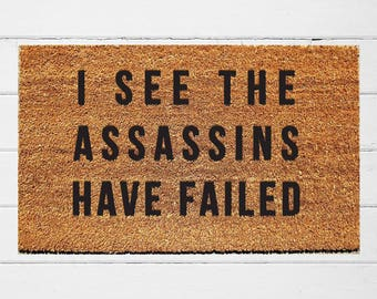 I See the Assassins Have Failed Doormat | Welcome Door Mat | Outdoor Rug |  Funny Doormat | Funny Welcome Mat | Quirky Gift