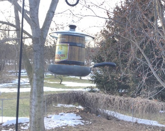 Frying beer can bird feeder