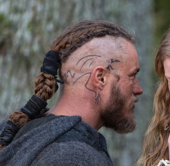 Image of Ragnar Lothbrok Raven Head Tattoo