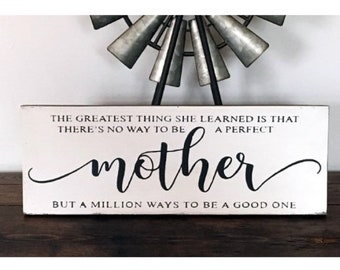 The greatest thing she learned is that there's no way to be a perfect Mother... wood sign