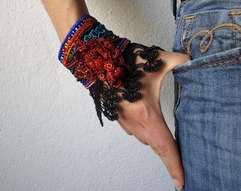 beaded freeform crochet cuff - bracelet with beaded crochet flowers and black crochet lace