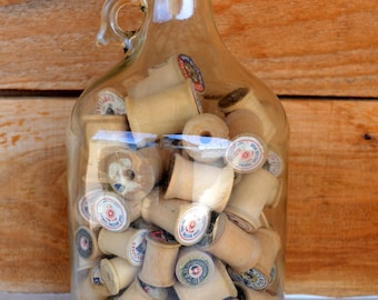 One Gallon Cork Plugged Jug Full of Vintage Wooden Thread Spools. Cork says Pure Honey!  A Honey of a Conversation Piece or Store Display!