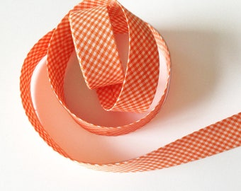 PRE-folded cotton fabric has small gingham orange Tangerine sold by the yard