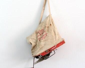 vintage seed sower or spreader, old garden tool, grass seeder