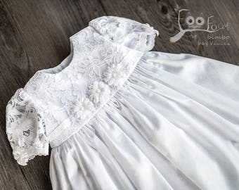 baptism dress in white with lace and flowers