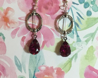 Antique silver hoop earrings with raspberry color accent beads in silver wires.
