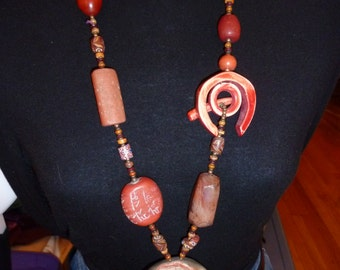 Beads and Stone Necklace. Primitive in Style. Heavy in Weight. Gorgeous in Detail. Clasp is one of the Stones.