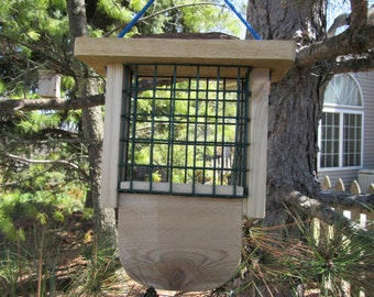 Cedar suet feeder with woodpecker tail prop