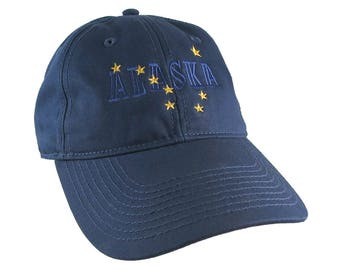 Alaska State Flag Symbol Blue and Gold Embroidery Design on an Adjustable Indigo Blue Unstructured Classic Baseball Cap Dad Hat