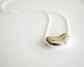 Elegant silver bean necklace