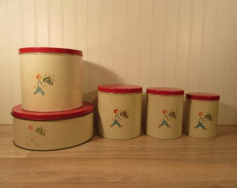 Nice set of 5 vintage metal canisters with red lids- c. 1940s  marked Rd 1947 GSW