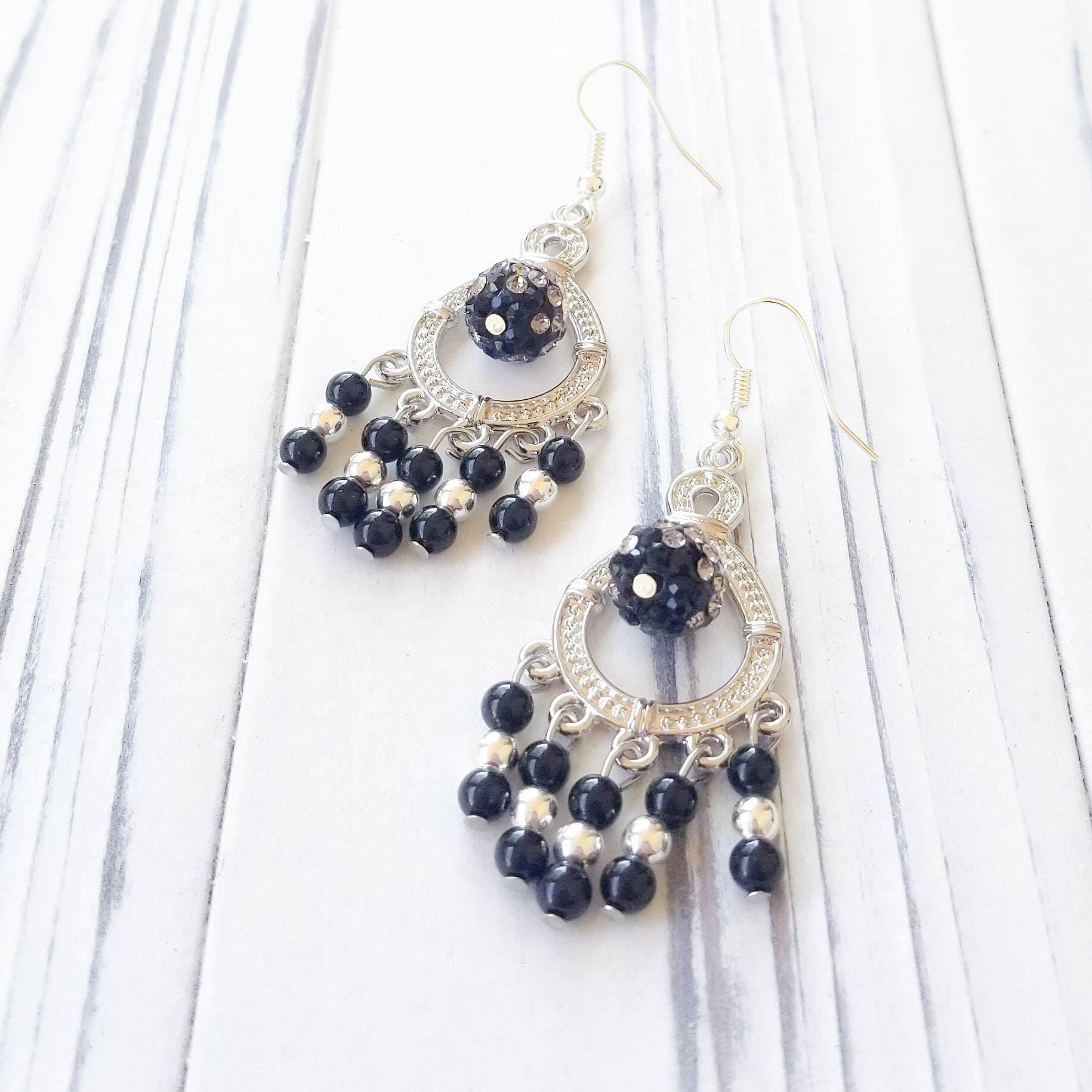 Black sparkle dangle chandelier earrings with a crystal studded bead arubaitofo Choice Image