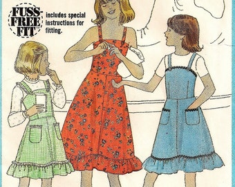 """A Ruffled Hemline, Buttoned Shoulder Straps Sundress and Jumper Sewing Pattern: Girls Size 10, Breast 28-1/2"""" • Simplicity 8544"""