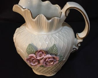 Vintage Pitcher With Raised Rose Design