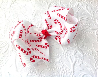 Candy cane bow: Christmas bow on an alligator clip. Red hair bow. Christmas bow headband. Red headband. Candy cane bow headband. 4 inch bow