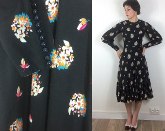 1970s Wool Black and Floral dress with bishop sleeves and tiered skirt