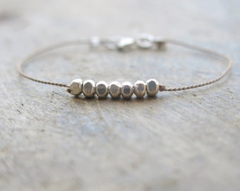 Fine silver minimalist bracelet with nugget beads on a brown silk thread Mother's day gift.