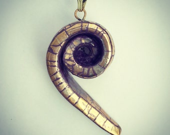 Gold spiral pendant.