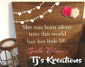 She was born silent into this world wooden stained sign