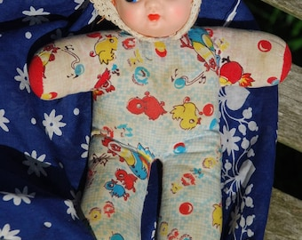 Squeaky doll with birdy pattern