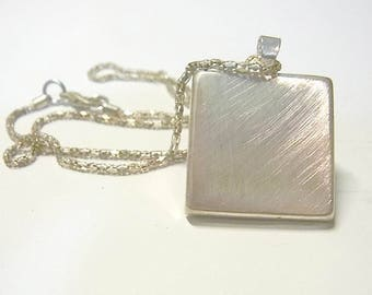 pendant, brushed silver or flowers reversible necklace