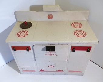 Vintage, EMPIRE play stove 1950s era! Oven is tin litho construction, White, Red with black knobs.