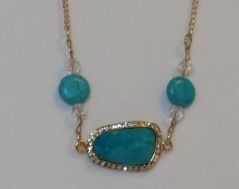 Turquoise rectangle medallion with rhinestones
