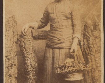 CDV of girl holding a basket of flowers/ carte de visite