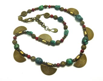 * Ethnic necklace in turquoise, coral bead and bronze carved beads